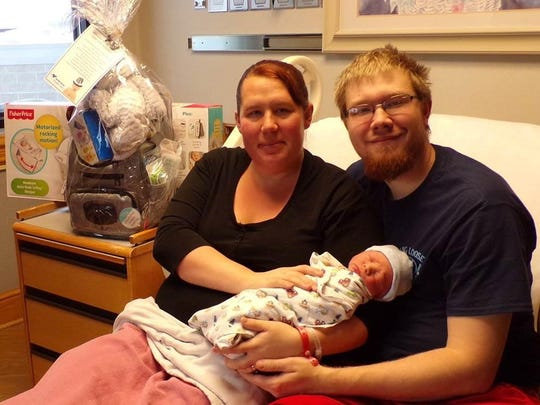 Misty Perocai and Dustin Mohar cuddle Corbin Paul Mohar at the Northern Montana Hospital.