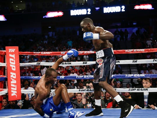 Terence Crawford stands over Julius Indongo following