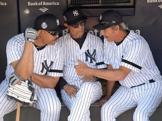 New York Yankees' Jesse Barfield, left, Roy White, and Ron Guidry talk in the dugout before the Yankees Old Timers' Day baseball game Sunday, June 17, 2018, at Yankee Stadium in New York.