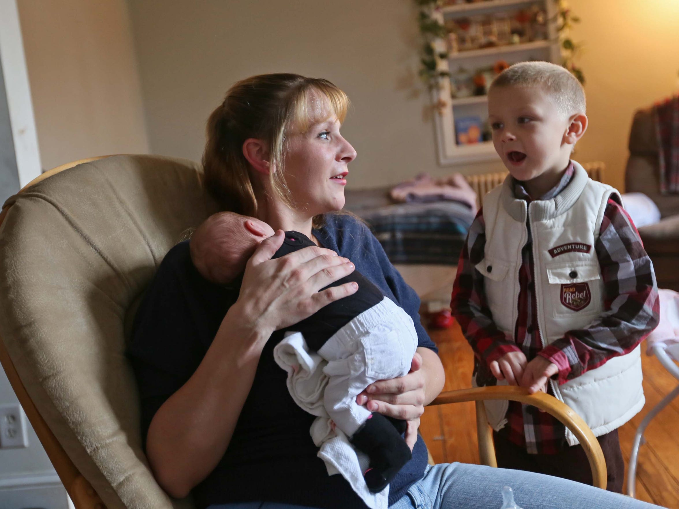 31 year-old Courtney Murphy rocks her 2-week-old daughter Sophia while talking to Daniel, her 6-year-old son. A younger son, 2-year-old Duke, and Sophia were both born while Murphy was using methadone to treat her addiction to heroin.