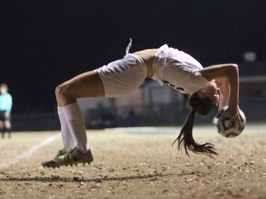 Leon's Madison Rumenik performs a flip throw during Friday's District 2-4A championship won by the Lions 2-0.