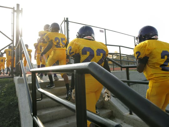 East High School players enter the field for a modified football game against Monroe.