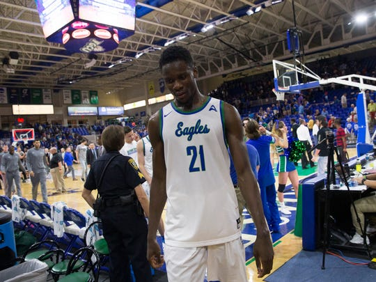 FGCU's Demetris Morant (21) walks off the court after narrowly losing to USC Upstate 62-60 at Alico Arena Thursday, Jan. 19, 2017 in Estero.