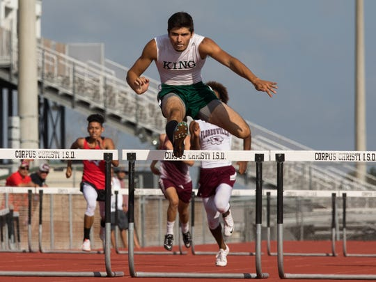 King's Noah Elizondo competes in the 300-meter hurdles during the 29-5A/30-5A area meet at Cabaniss Multipurpose Complex on Thursday April 20, 2017.