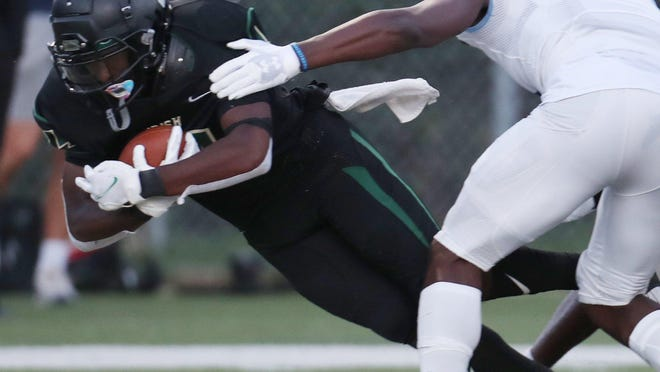 St. Vincent-St. Mary's Josh Nickerson dives for a touchdown against Cleveland Benedictine on Friday, Sept. 4, 2020, at Green Street Stadium and John Cistone Field in Akron.