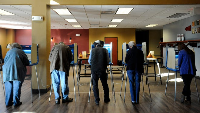 Community members vote at Crosswalk Community Church in Sioux Falls, S.D., Tuesday, Nov 4, 2014.