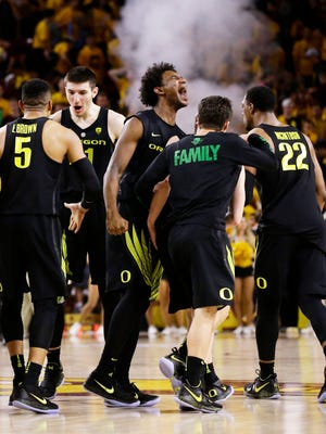 Oregon celebrates their 76-72 win over Arizona State during PAC-12 action on Jan. 11, 2018 in Tempe, Ariz.