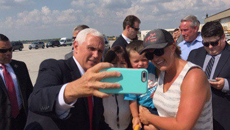 Vice President Mike Pence and Karen Pence pause for a selfie with a supporter. The Pences arrived at Indianapolis International Airport today, the vice president will deliver a speech on tax reform this afternoon in Anderson.