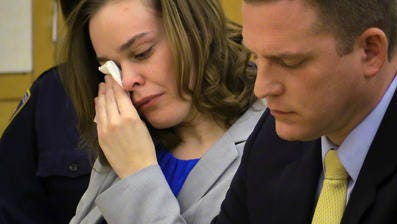 Lacey Spears wipes away tears during the prosecution's opening statement Tuesday.