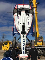 The IndyCar hanging from a crane that will be used