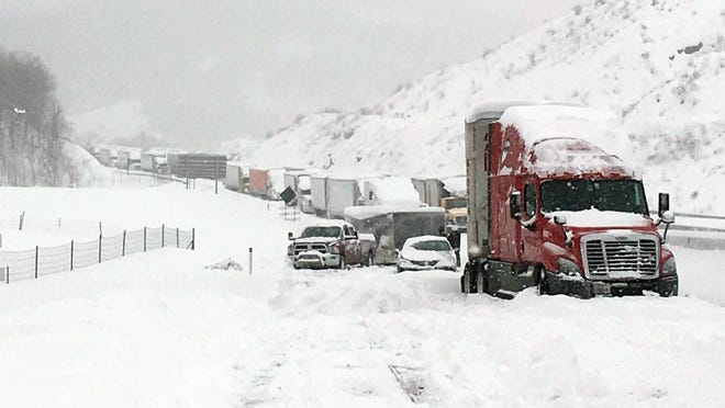 Traffic is at a standstill on the Pennsylvania Turnpike near Bedford, Pa., on Saturday.