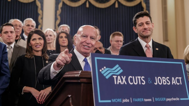 House Ways and Means Committee chairman Kevin Brady, R-Texas, joined by Speaker of the House Paul Ryan, R-Wis., right, discusses the GOP's far-reaching tax overhaul, the first major revamp of the tax system in three decades, on Capitol Hill on Nov. 2.