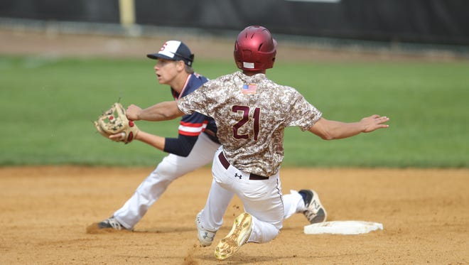 Stepinac shortstop Matt Careccia (10) attempts a tag on Iona Prep baserunner Anthony Piccolino (21) during baseball action at Iona Prep High School in New Rochelle on Friday, May 12, 2017.  Iona Prep won 10-0.