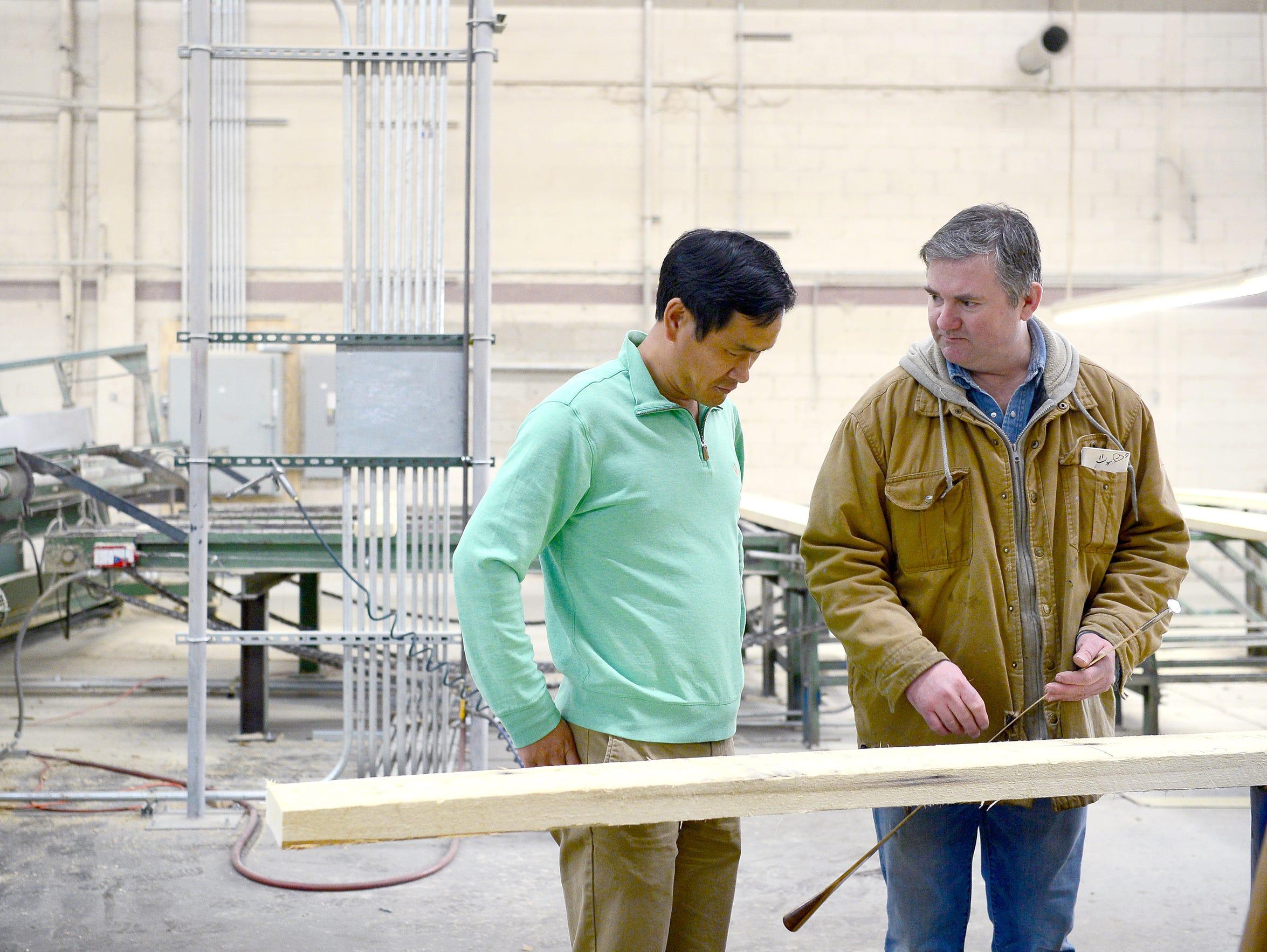Jimmy Lee, owner of Oak Valley Hardwoods, talks with