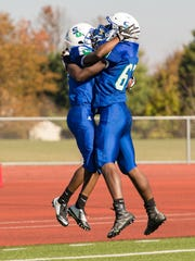 Damani Wells and Brian Rush of St. Georges celebrate Wells' touchdown in a 2016 game against DMA.