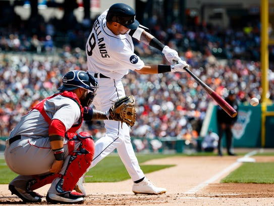Tigers third baseman Nick Castellanos hits a single
