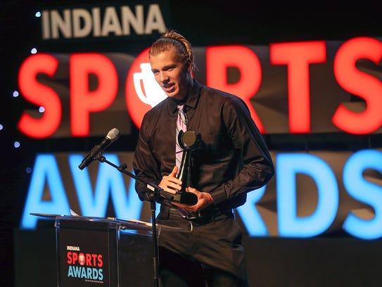 Carmel swimmer Drew Kibler accepted his award for top