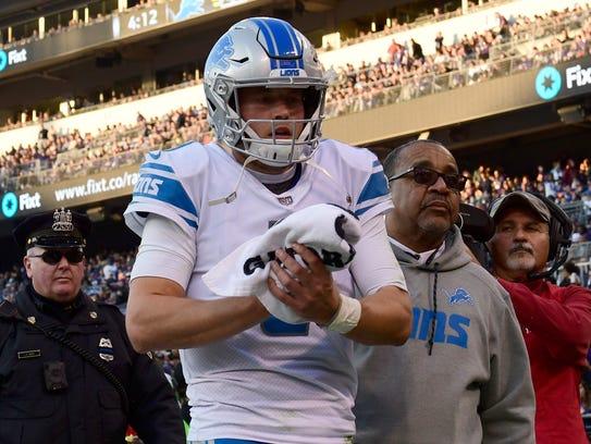 Lions quarterback Matthew Stafford leaves the game