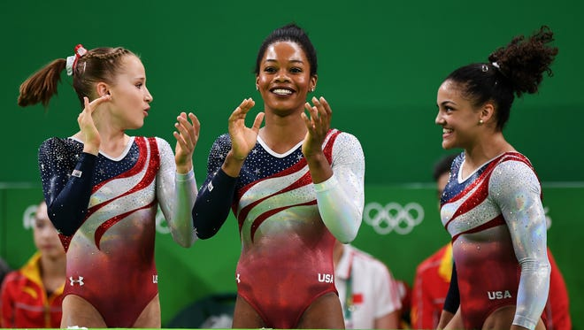RIO DE JANEIRO, BRAZIL - AUGUST 9:  Madison Kocian (left), Gabrielle Douglas (center) and Lauren Hernandez of the United States congratulate Alexandra Raisman after competing on the floor during the Artistic Gymnastics Women's Team Final on Day 4 of the Rio 2016 Olympic Games at the Rio Olympic Arena on Aug. 9, 2016 in Rio de Janeiro, Brazil.  (Photo by Laurence Griffiths/Getty Images)