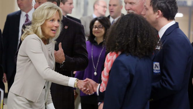 Jill Biden is greeted by McGavock High School seniors Tianna Shaw-Wakeman and Elijah Rawlings during a tour of the school Wednesday, Jan. 27, 2016.