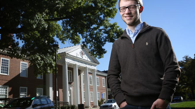 University of Louisville student Brandon McReynolds, in front of the Brandeis School of Law. McReynolds is a student who applied to U of L law school then decided not to go because he didn't want to be saddled with debt. He is now a PhD candidate. Oct. 8, 2014.