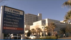 A sign directs patients and visitors to the UC Davis