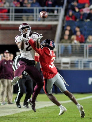 Nov 18, 2017; Oxford, MS, USA; Texas A&M Aggies wide receiver Jhamon Ausbon (2) catches a pass against Mississippi Rebels defensive back Jaylon Jones (31) during the first half at Vaught-Hemingway Stadium. Mandatory Credit: Justin Ford-USA TODAY Sports