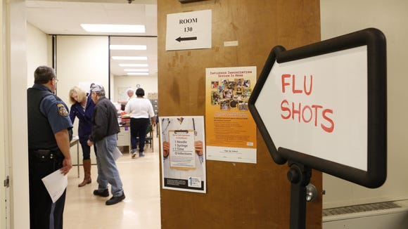 People sign up to receive flu shots at the Rockland County Health Department, Oct. 2, 2015 in Pomona.