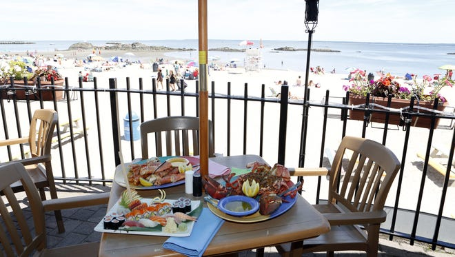 The sushi and seafood combination, the Alaskan king crab legs and the Maine lobster stuffed with jumbo lump crab meat are photographed at Seaside Johnnies in Rye.