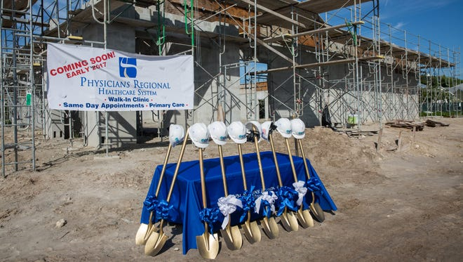 Hard hats and shovels are set up at the groundbreaking ceremony for the Physicians Regional Healthcare System walk-in clinic on Wednesday Sept. 7, 2016 in East Naples, Florida.