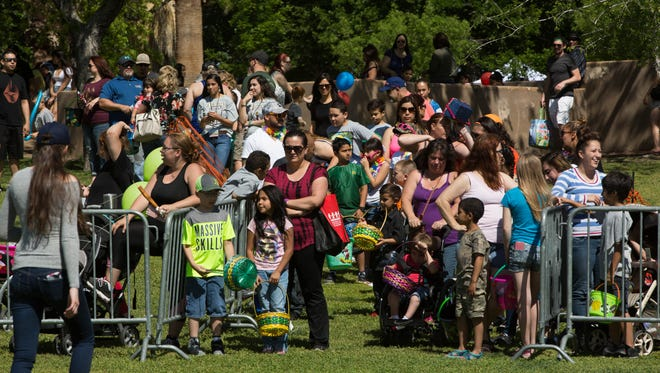 Children and their parents line up and wait to enter the egg hunt area at Springfest 2017 at Young Park, Saturday, April 15, 2017.