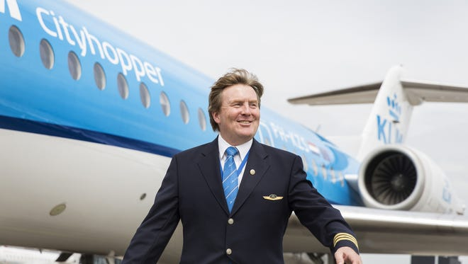 This handout photo taken on May 16, 2017 and provided by the KLM Royal Dutch Airlines on May 17, 2017 shows Dutch King Willem-Alexander posing in front of a KLM Cityhopper aircraft at Schiphol Airport, near Amsterdam.