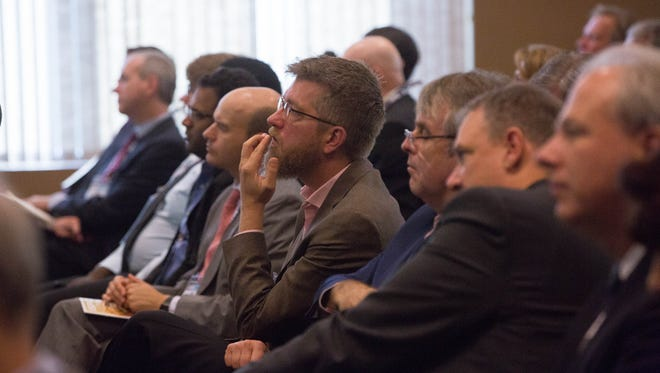 Leaders in the aerospace industry listen to Thomas Siems from the Federal Reserve Bank, during his presentation at the International Symposium for Person and Commercial Spaceflight. Wednesday October 11, 2017 held at the New Mexico Farm and Ranch Heritage Museum.