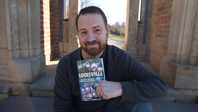 Kevin Gibson poses with his book Secret Louisville on the steps of the mansion facade
