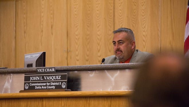 John Vasquez, vice chair and county commissioner for district 5, looks on as Johana Bencomo addresses the Doña Ana County Commission about a recent Facebook exchange between himself and Bencomo. Thursday January 25, 2018 at the County Commission meeting.