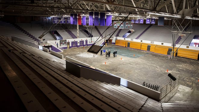 Officials with the City of Muncie and Muncie Community Schools look over the inside of the Central Fieldhouse on Feb. 12, months after a portion of the roof collapsed due to heavy storms and tornados that swept through the area. The building was insured for nearly $10 million after the storm struck.