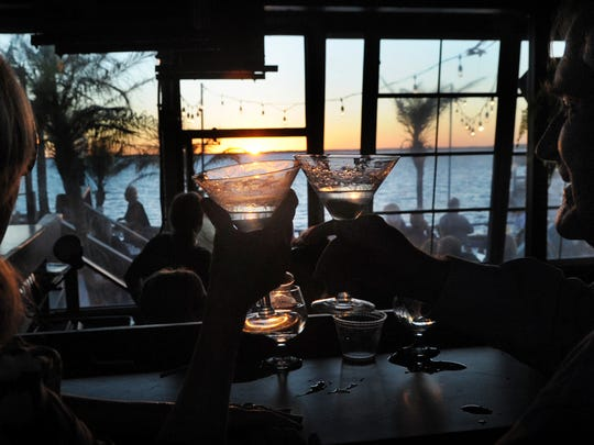 A toast at sunset at Fager's Island on 60th Street