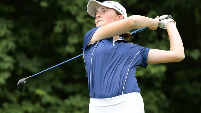 Winner Katie Hallinan drives from the 17th tee during the championship round of the 101st annual Metropolitan Women's Amateur at the Western Hills Country Club in Cincinnati on Thursday, June 23, 2016.
