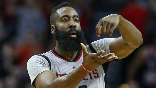 James Harden celebrates after scoring a basket during the third quarter against the Oklahoma City Thunder at Toyota Center.