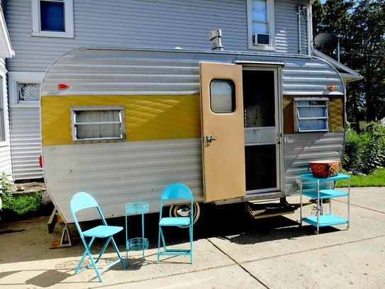"""A1965 Frolic camper, nicknamed a """"canned ham"""" camper,"""