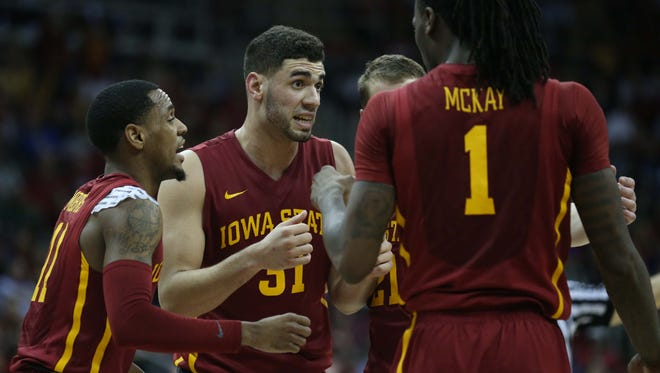 Iowa State players, Monte Morris, Georges Niang, Matt Thomas and Jameel McKay huddle on the court during the Iowa State vs. Oklahoma Big 12 Tournament game on Thursday, March 10, 2016, at the Sprint Center in Kansas City. The Cyclones fell to the Sooners 79-76.