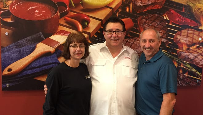 Michelle and Delon Robinson, local owners of the new Bonanza Steakhouse in Chambersburg, are joined by Tom Sacco (center), CEO, Homestyle Dining, Bonanza Steakhouse's parent company. The restaurant had its grand opening on Sept. 14.