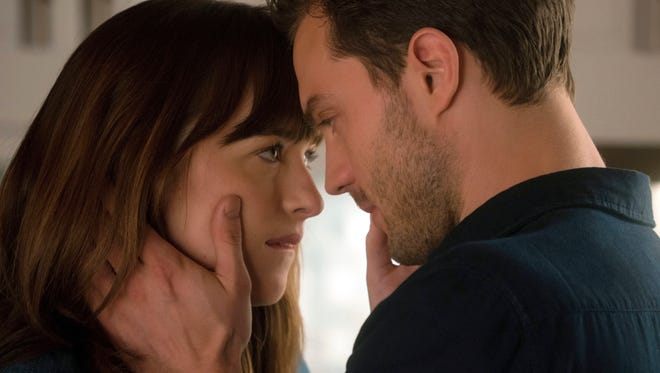 """Anastasia Steele (Dakota Johnson, left) and Christian Grey (Jamie Dornan) put their heads together to figure things out in """"Fifty Shades Darker."""""""