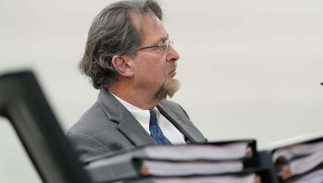 Dover psychiatrist Gregory Villabona, who had his license suspended in late March following an attorney general investigation, listens to opening statements at a public disciplinary hearing.