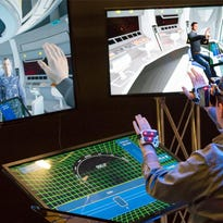 Caption: Ryan Spicer, a programmer at the University of Southern California's Mixed Reality Lab,  is put on-board a ship's bridge using mixed reality technology. Credit: Todd Richmond