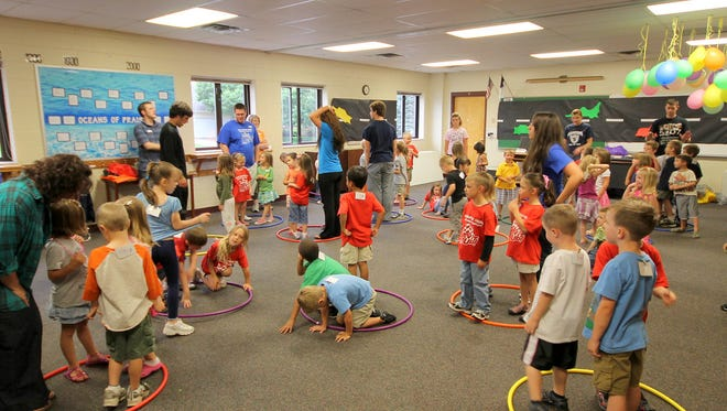 Hula Hoop and balloon games engage children in Vacation Bible School in 2011 at Faith Church.