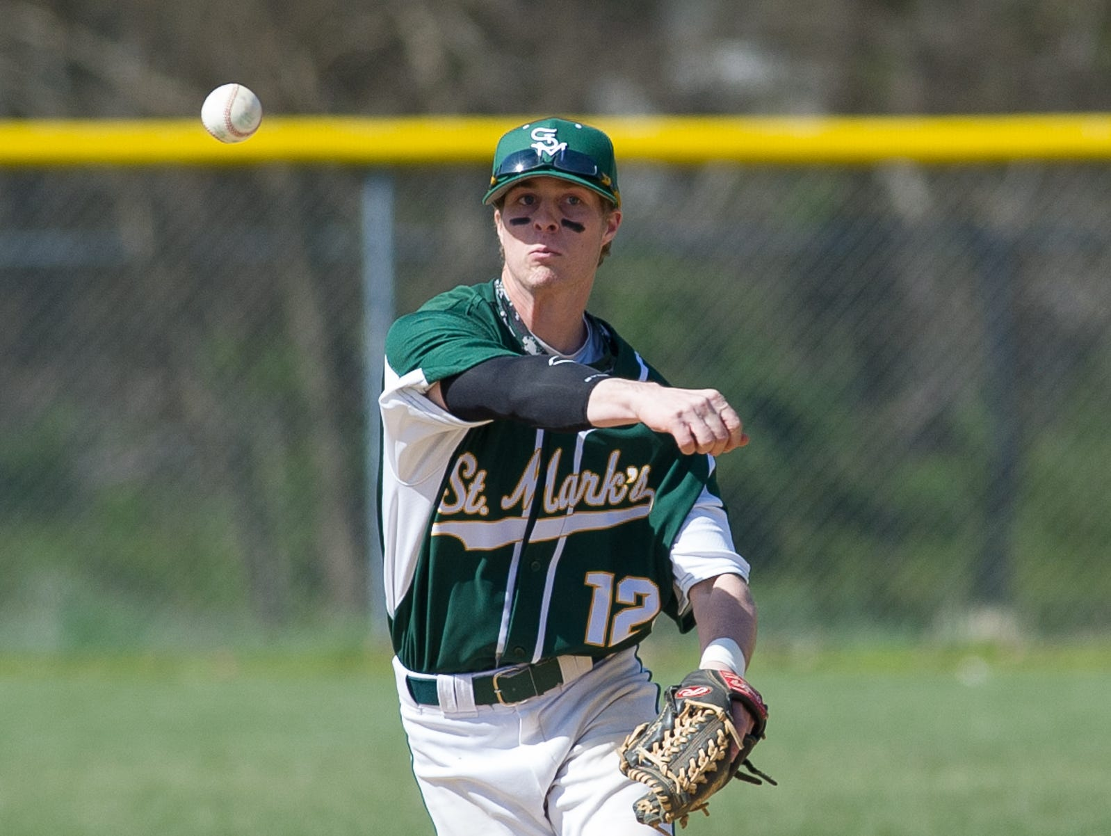 St. Mark's John Panico (12) throws to first base in their win over Caesar Rodney.
