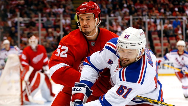 Detroit Red Wings defenseman Jonathan Ericsson and New York Rangers left wing Rick Nash (61) battle for position Dec. 6, 2014.