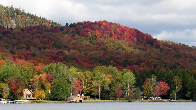 Colors show on the hills surrounding the Fulton Chain of Lakes near Old Forge, NY.