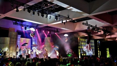 The Steve Chase Humanitarian Awards Gala featured spectacular dancing, note acrobats performing above stage.